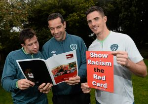 13 October 2013; The FAI and anti-racism education charity 'Show Racism the Red Card' announced details today of the upcoming FARE activities taking place in Ireland, which runs from the 15th to the 29th of October. Highlights of the fortnight will include a multicultural procession of children accompanying players onto the pitch for the forthcoming Ireland v Kazakhstan game, as well as the unfurling of giant anti-racism banners during various international and Airtricity League games by football supporters. In addition, FAI Development Officers will deliver 'Show Racism the Red Card' workshops to children in over 100 schools, reaching an anticipated 6,000 young people over the course of the two weeks. Pictured at the launch is Republic of Ireland's Sean St.Ledger, left, David Forde and Ciaran Clark, right. Portmarnock Golf Links Hotel, Portmarnock, Co. Dublin. Picture credit: David Maher / SPORTSFILE *** NO REPRODUCTION FEE ***