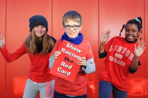DC 25/11/2016 - REPRO FREE FREE PIC Pupils from Midleton Educate Together School in Cork, Ava Murphy, 12, Luke Morrissey, 11, and Jemima Kumalo, 10, pictured taking part in the inaugural Wear Red Day against racism organised by Show Racism the Red Card. Minister of State for Justice with special responsibility for Equality, Immigration and Integration, David Stanton TD, attended a special event at the school, one of many events that took place across the country. Thousands of people wore red to support Show Racism the Red Card on Friday 25th November across 35 schools and dozens of clubs, colleges and workplaces across Ireland. For further information on the initiative, visit http://www.theredcard.ie/. Pic: Diane Cusack